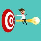 Businessman riding a dart lightbulb to target Stock Images