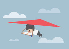Businessman riding a hang glider Royalty Free Stock Photo