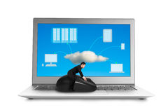 Businessman riding on mouse with cloud computing image on screen Stock Image