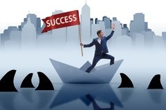 The businessman riding paper boat ship in success concept Royalty Free Stock Photo