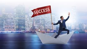 The businessman riding paper boat ship in success concept Royalty Free Stock Photography