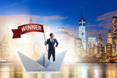 The businessman riding paper boat ship in winning concept Stock Photography
