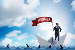 The businessman riding paper boat ship in winning concept Stock Photos
