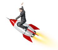 Businessman riding red rocket Stock Photography