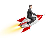 Businessman riding red rocket Royalty Free Stock Photos