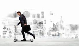 Businessman riding scooter Stock Photos