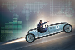 The businessman riding sports car against charts Stock Photos