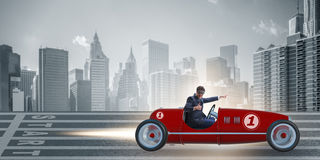 The businessman riding vintage roadster in motivation concept Stock Images