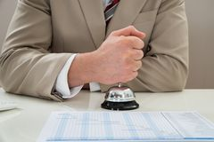 Businessman ringing service bell Stock Image