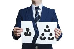 Businessman ripped a piece of paper as a symbol of disagreement in the team. Dismissing one team member. Businessman removes / royalty free stock photos