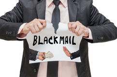 Businessman ripping up the BLACKMAIL sign with refusing the money Royalty Free Stock Photos