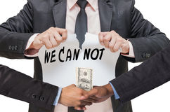 Businessman ripping up the WE CAN NOT sign with Hand shake between a businessman Royalty Free Stock Images