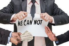 Businessman ripping up the WE CAN NOT sign with refusing the mon Stock Photography