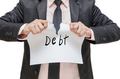 Businessman ripping up the Debt sign Stock Photos