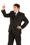 Businessman with rised finger. Idea gesture. Royalty Free Stock Image