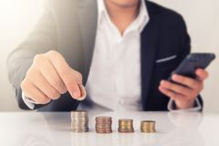 Businessman with rising coins. A business man with rising coins Stock Image