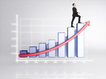 Businessman rising up. Businessman in suit rising up on diagram Stock Photography
