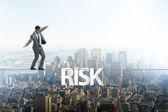 The businessman in risk concept walking on tight rope. Businessman in risk concept walking on tight rope royalty free stock image