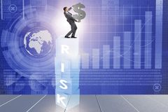 The businessman in risk and reward business concept Stock Photo