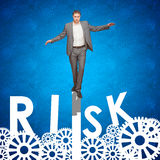Businessman risking it. Business man walking on a gear. Concept for risk and ideas, all leading to success Stock Photo