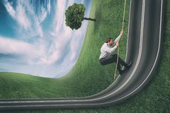 Businessman climbs a road bent upwards. Achievement business goal and difficult career concept. Businessman on a road that bends upwards royalty free stock photos
