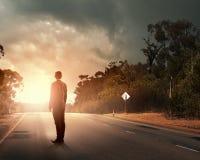 Businessman on road Stock Photo