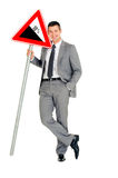 Businessman with road sign. In white background Royalty Free Stock Images