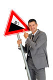Businessman with road sign Stock Photos
