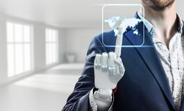 Businessman with robot hand touches world map icon. Businessman with robot hand touches world map icon in white office. Elements of this image furnished by NASA Stock Photos