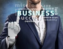Businessman with robotic hand point on business word cloud. 3d rendering Stock Photography