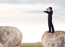 Businessman on rock mountain Royalty Free Stock Photography
