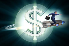The businessman on rocket flying around dollar Royalty Free Stock Photo