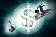 The businessman on rocket flying around dollar. Businessman on rocket flying around dollar Stock Photography