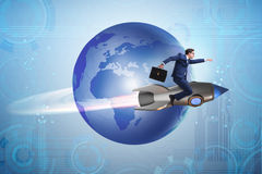 The businessman on the rocket in global business concept Royalty Free Stock Image