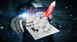 Businessman with rocket launching from a laptop 3D rendering. Businessman on blurred background with rocket launching from a laptop 3D rendering Royalty Free Stock Image