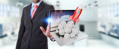 Businessman with rocket launching from a laptop 3D rendering. Businessman on blurred background with rocket launching from a laptop 3D rendering Royalty Free Stock Images