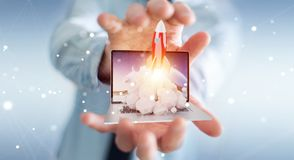 Businessman with rocket launching from a laptop 3D rendering. Businessman on blurred background with rocket launching from a laptop 3D rendering Stock Image