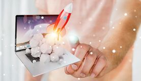 Businessman with rocket launching from a laptop 3D rendering. Businessman on blurred background with rocket launching from a laptop 3D rendering Stock Images