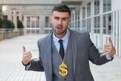 Businessman rocking golden necklace with dollar sign stock photos