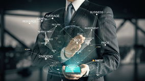 Businessman with ROI hologram concept. Businessman with hologram in the future with futuristic tablet with success words stock footage