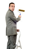 Businessman With Roller Brush Stock Photography