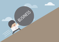 Businessman rolling ball with message 'BUSINESS' up on hill. VECTOR, EPS10 royalty free illustration