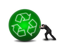Businessman rolling large green ball with recycle symbol on it i. Solated in white background Royalty Free Stock Photo