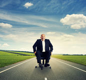 Businessman rolling on the office chair Royalty Free Stock Image