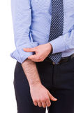 Businessman rolling up his shirt sleeves. Stock Image