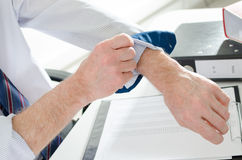 Businessman rolling up his sleeve Stock Photos