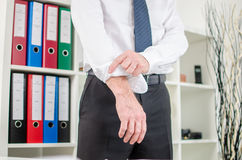 Businessman rolling up his sleeves Stock Image