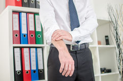 Businessman rolling up his sleeves Royalty Free Stock Images