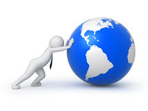 Businessman rolls the globe Stock Photo