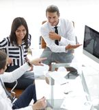 Businessman rolls his meeting with the business team Stock Image